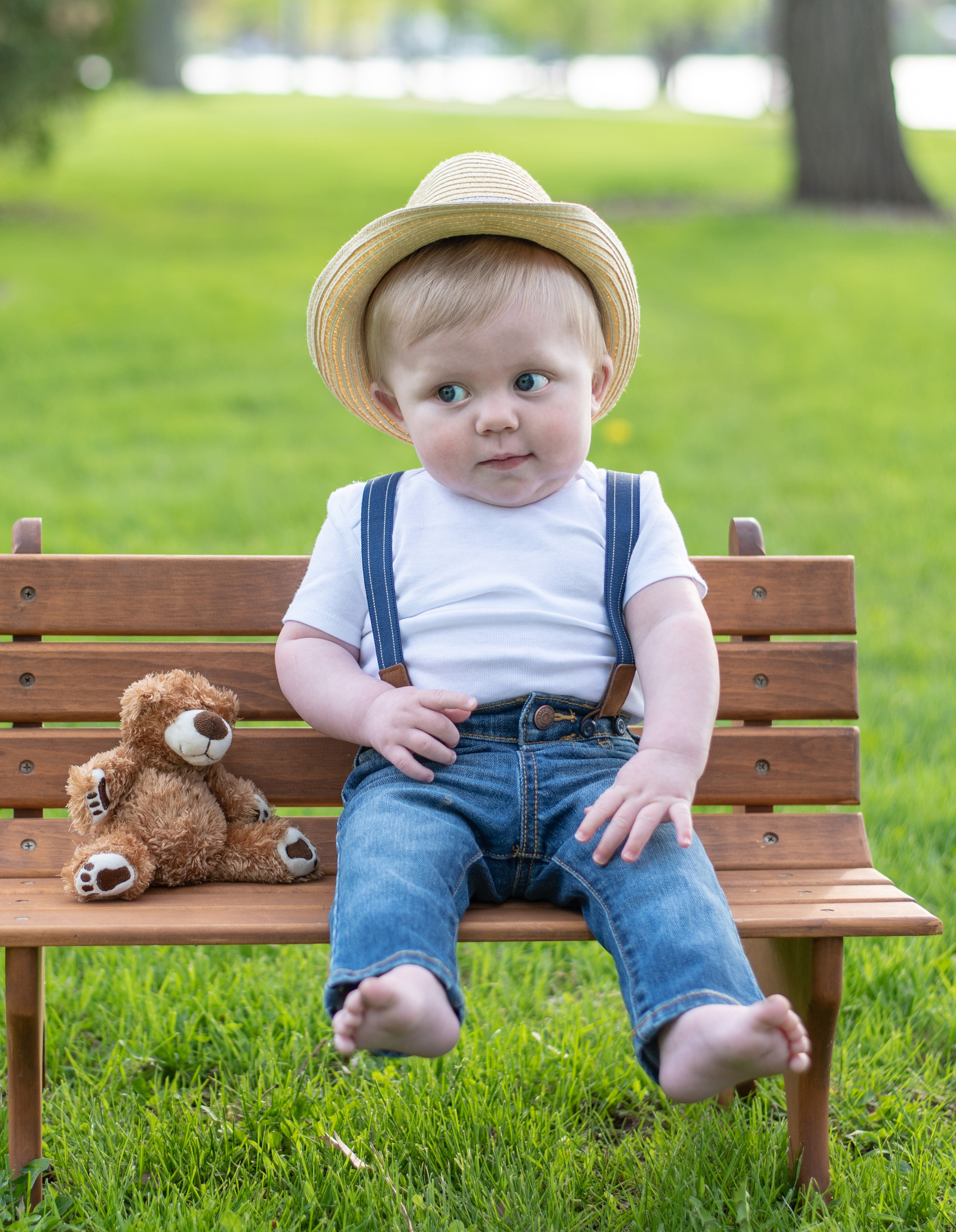 baby milestones 6 months old boy on bench with bear