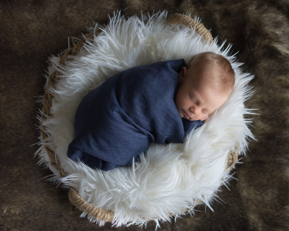 newborn baby boy in basket