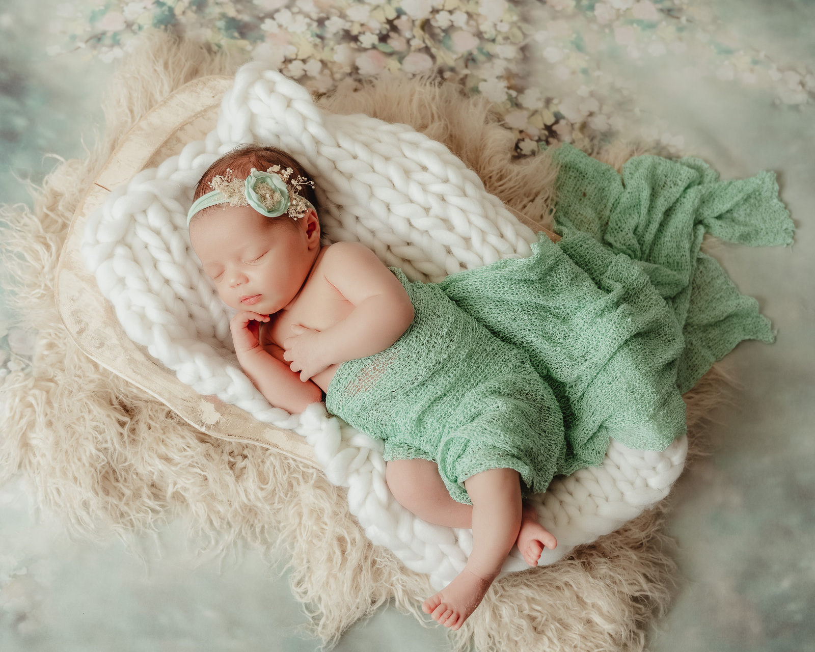 newborn baby girl on mint floral